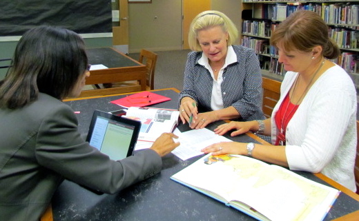 Clinical Practice Supervision Photo of University Supervisor Coaching Co-Teachers in Planning